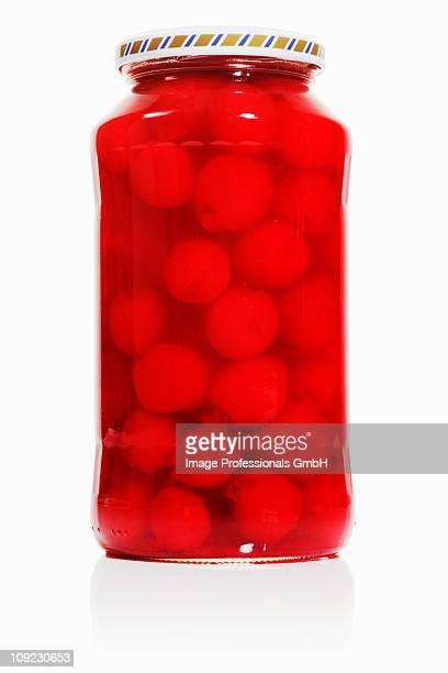 Jar of bottled cherries