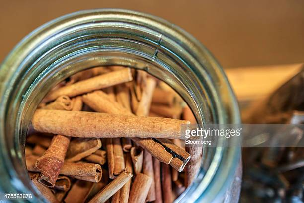 A jar of cinnamon sticks sits on display at a spice store in Cochin Kerala India on Friday May 29 2015 While consumerprice gains eased to a fourmonth...