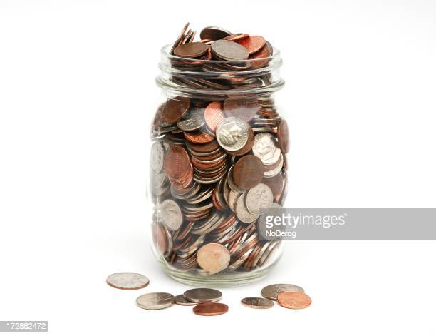 Jar of coins full and overflowing