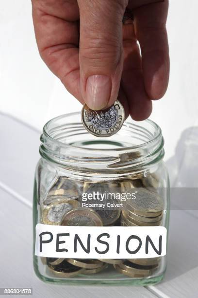 jar of coins, illustrating adding continually to a pension. - jar stock pictures, royalty-free photos & images