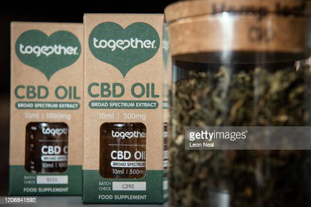 "Jar of hemp leaves is seen next to two bottles of ""Together"" CBD Oil in a branch of the health chain Planet Organic on February 17, 2020 in London,..."