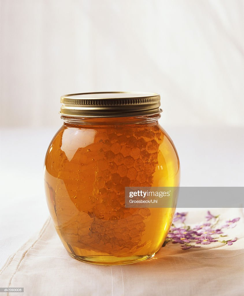 Jar of Honey and Honeycomb : Stock Photo