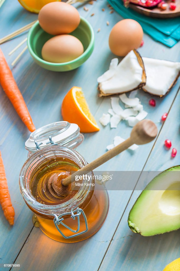 Jar of honey with dipper and fresh ingredients : Stock Photo
