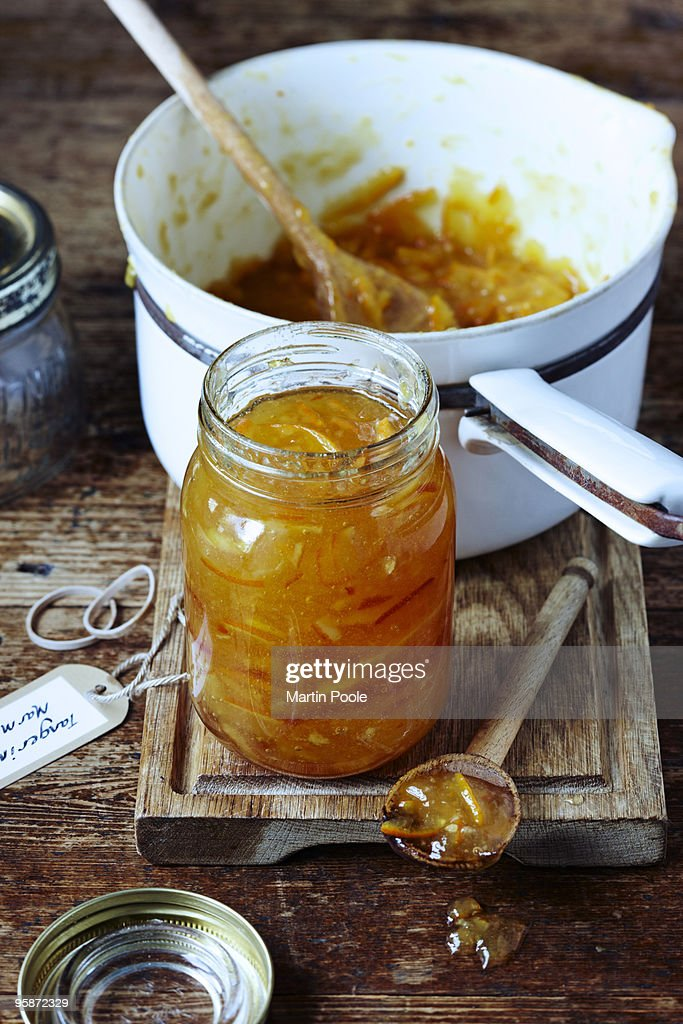 Jar of marmalade on table with pan : Stock Photo