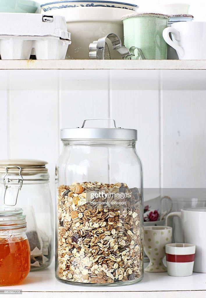 jar of museli in kitchen cupboard : Stock Photo