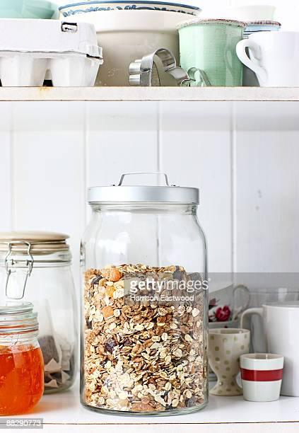 jar of museli in kitchen cupboard