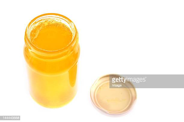 a jar of orange marmalade - lid stock photos and pictures
