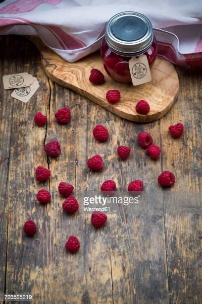 Jar of raspberry jam and raspberries