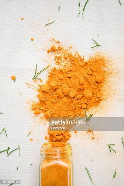 Jar of spilled spices and herbs