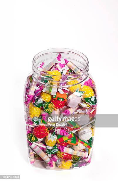 Jar of sweets from above on white background