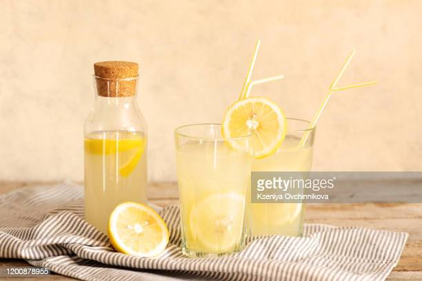 jar of tasty fresh lemonade with lemons in background - lemon soda stock pictures, royalty-free photos & images