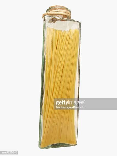 A jar of uncooked spaghetti