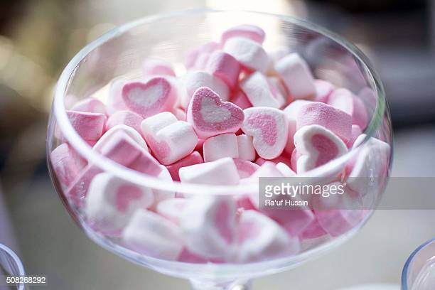 A jar or bowl of lovely pink heart marshmallows