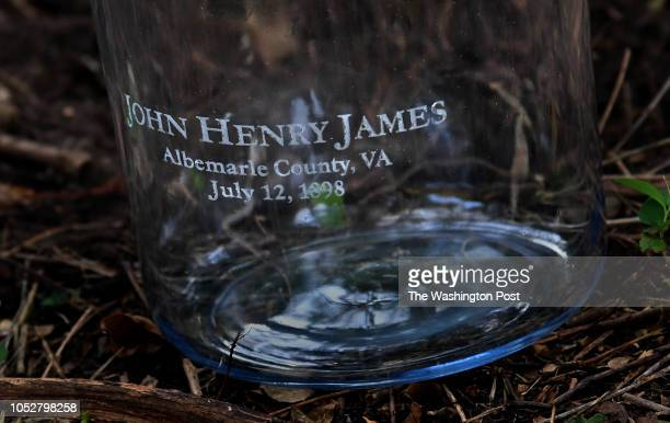A jar that was later filled with soil from a lynching site near downtown Charlottesville Virginia The name of the victim and the date of the crime is...