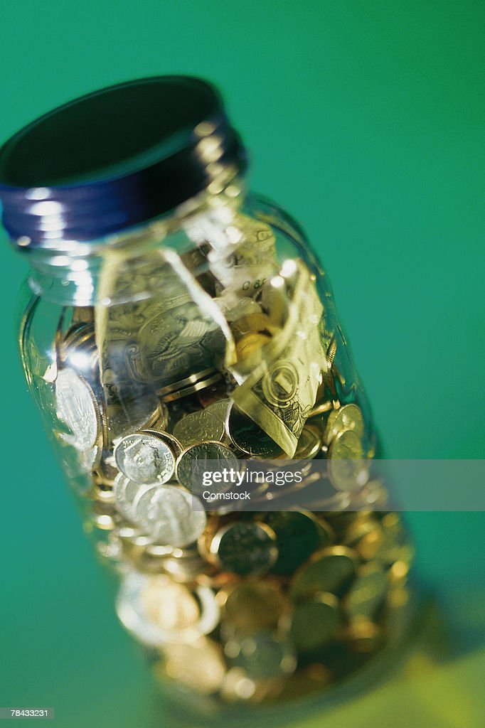 Jar with coins : Stockfoto