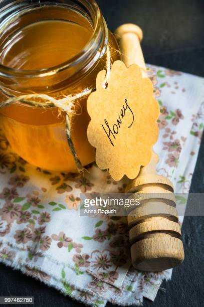 jar with honey - wild honey spoonful stock pictures, royalty-free photos & images