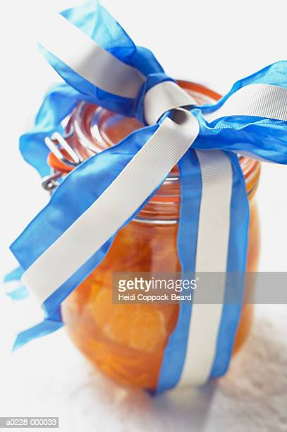 jar with ribbon - heidi coppock beard stock pictures, royalty-free photos & images