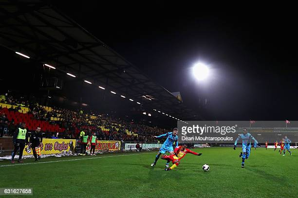 Jarchinio Antonia of Go Ahead Eagles is tackled and fouled during the Dutch Eredivisie match between Go Ahead Eagles and AZ Alkmaar held at De...