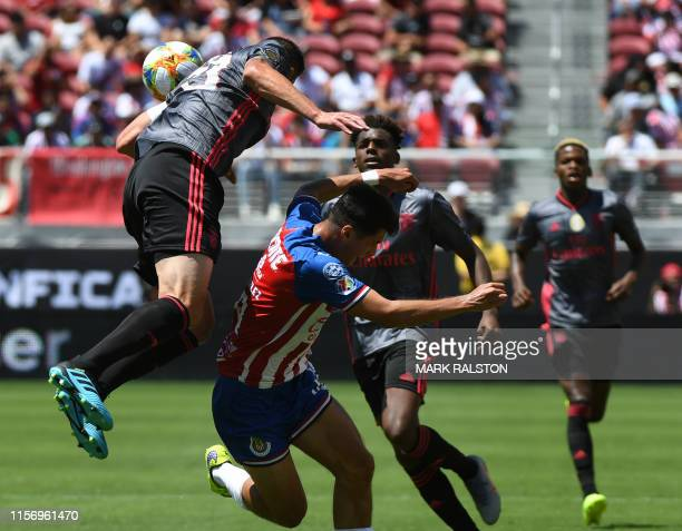 Jardel of Benfica clashes with El Tepa of Chivas de Guadalajara during their 2019 International Champions Cup match at the Levi's Stadium in Santa...