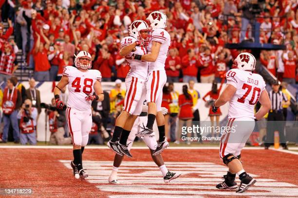 Jared Abbrederis and Jeff Duckworth of the Wisconsin Badgers celebrate after Duckworth scored 3-yard touchdown reception against the Michigan State...