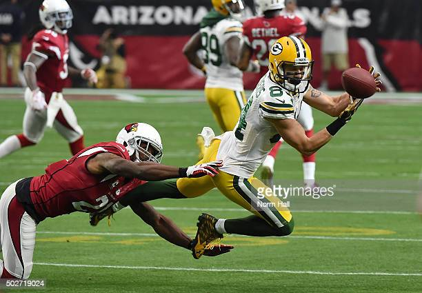 Jared Abbrederis of the Green Bay Packers attempts to make a diving catch against the Arizona Cardinals at University of Phoenix Stadium on December...