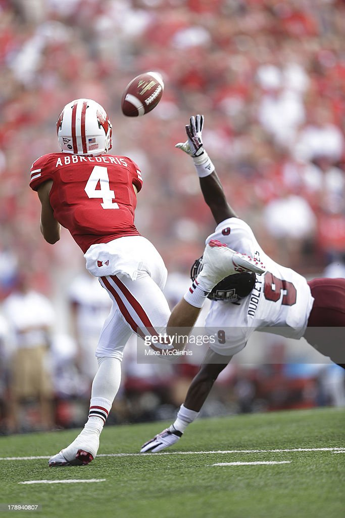 Jared Abbrederis #4 of the Wisconsin Badgers makes an outstanding catch for a touchdown with Trey Dudley-Giles #9 of the UMass Minutemen defending during the game at Camp Randall Stadium on August 31, 2013 in Madison, Wisconsin.