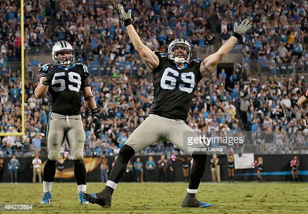 Jared Allen of the Carolina Panthers celebrates a 4th quarter sack against the Philadelphia Eagles while Luke Kuechly looks on during their game at...