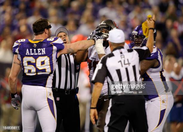 Jared Allen of the Minnesota Vikings and Donald Penn of the Tampa Bay Buccaneers get into an altercation as umpire Carl Paganelli and Christian...