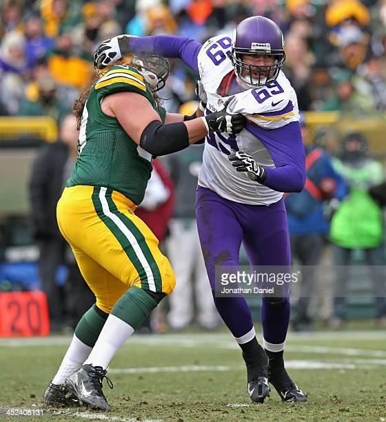 Jared Allen of the Minnesota Vikings rushes against David Bakhtiari the Green Bay Packers at Lambeau Field on November 24 2013 in Green Bay Wisconsin...