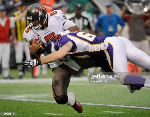 Jared Allen of the Minnesota Vikings sacks Josh Freeman of the Tampa Bay Buccaneers in the first quarter on September 18 2011 at the Hubert H...