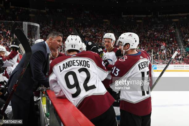 Jared Bednar of the Colorado Avalanche talks to his players during a time out during a game against the Arizona Coyotes at Gila River Arena on...