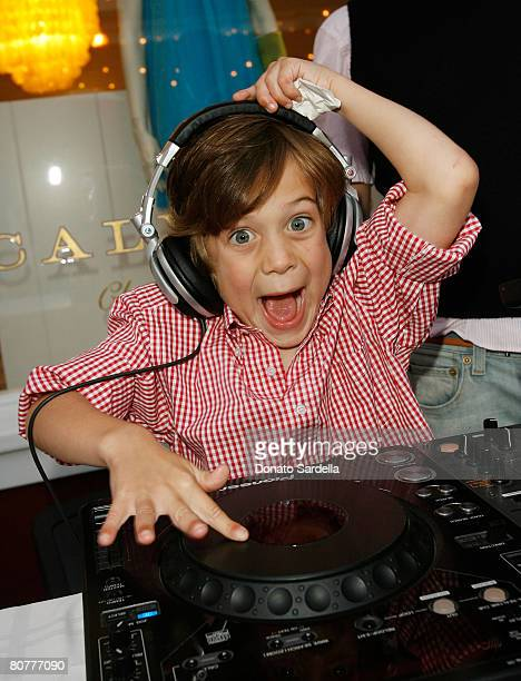 Jared Belushi son of Jim and Jenny Belushi plays with the DJ's decks during the Poppy store opening to benefit Stuart House April 14 2008 in Santa...