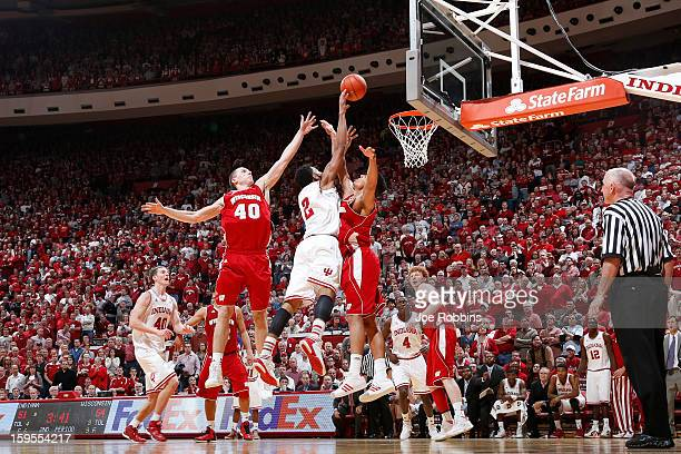 Jared Berggren and Ryan Evans of the Wisconsin Badgers defend a shot against Christian Watford of the Indiana Hoosiers during the game at Assembly...