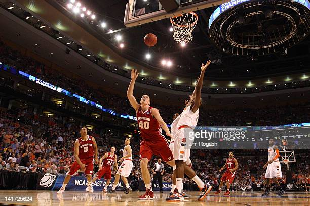 Jared Berggren of the Wisconsin Badgers goes to the hoop against Rakeem Christmas of the Syracuse Orange during their 2012 NCAA Men's Basketball East...