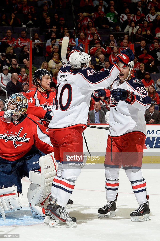 Jared Boll #40 celebrates with Michael Chaput #39 of the Columbus Blue Jackets after scoring a goal in the third period during an NHL game against the Washington Capitals at Verizon Center on November 12, 2013 in Washington, DC.