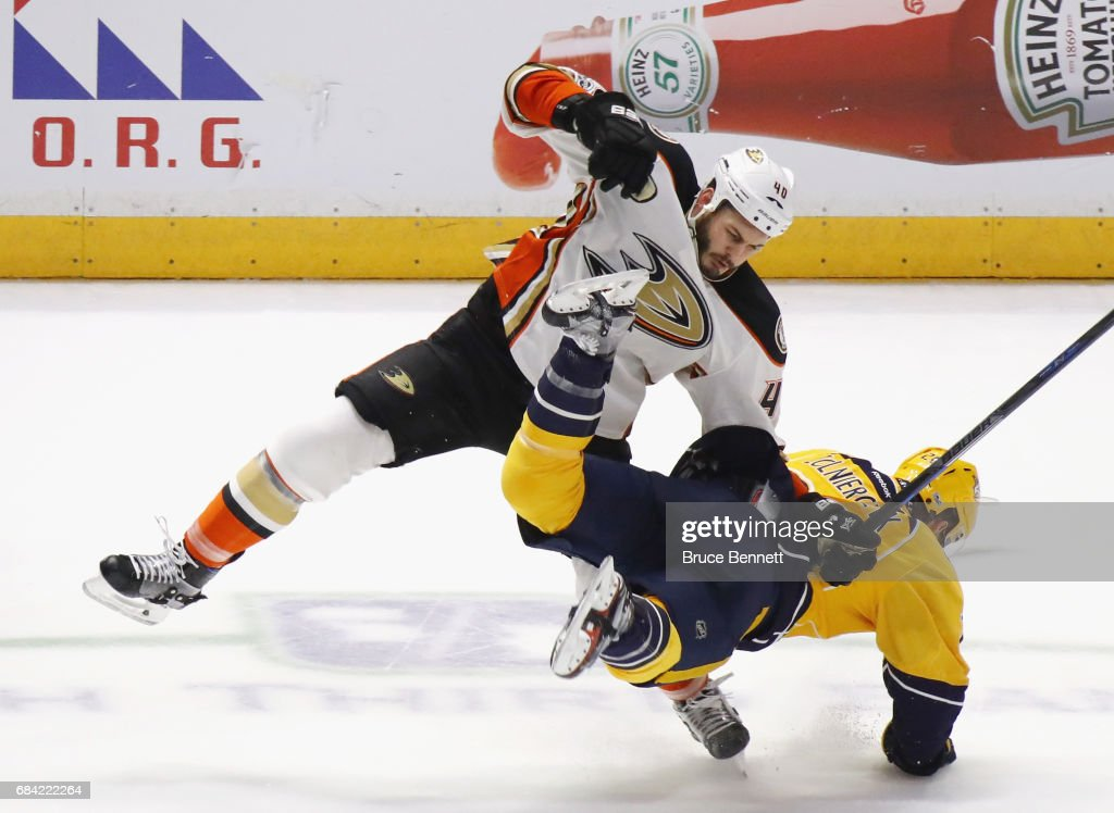 Jared Boll #40 of the Anaheim Ducks hits Harry Zolnierczyk #26 of the Nashville Predators in Game Three of the Western Conference Final during the 2017 NHL Stanley Cup Playoffs at the Bridgestone Arena on May 16, 2017 in Nashville, Tennessee. The Predators defeated the Ducks 2-1.