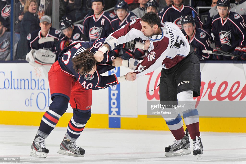 Jared Boll #40 of the Columbus Blue Jackets and Patrick Bordeleau #58 of the Colorado Avalanche fight in the second period on March 3, 2013 at Nationwide Arena in Columbus, Ohio. Columbus defeated Colorado 2-1 in overtime.