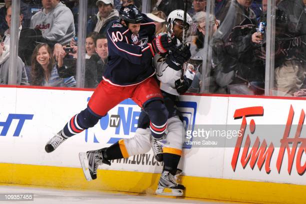 Jared Boll of the Columbus Blue Jackets gets called for charging after hitting Joel Ward of the Nashville Predators during the second period on...