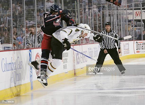 Jared Boll of the Columbus Blue Jackets is hit by the check of Mattias Norstrom of the Dallas Stars on October 17, 2007 at Nationwide Arena in...