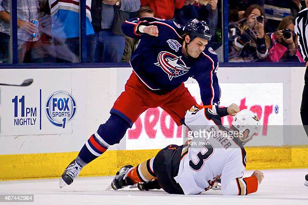 Jared Boll of the Columbus Blue Jackets throws a punch against Clayton Stoner of the Anaheim Ducks during the second period on March 24 2015 at...