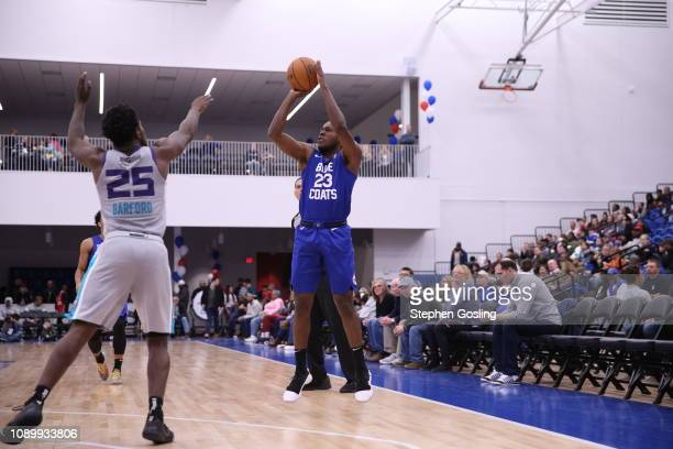 Jared Brownridge of the Delaware Blue Coats shoots against Jaylen Barford of the Greensboro Swarm during an NBA GLeague game at the 76ers Fieldhouse...