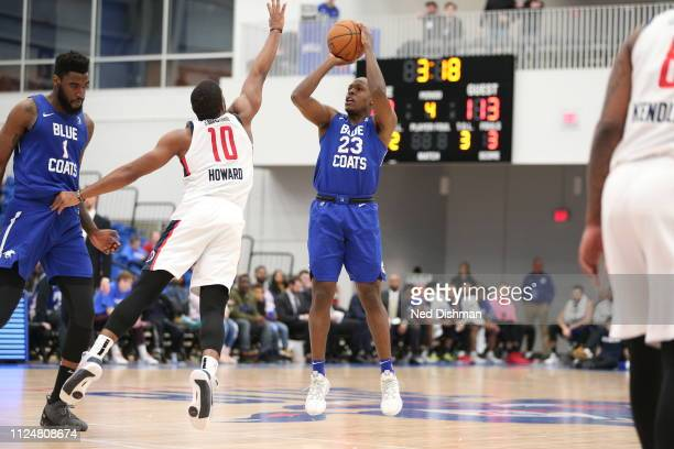 Jared Brownridge of the Delaware Blue Coats shoots against Pe'Shon Howard of the Capital City GoGo during an NBA GLeague game at the 76ers Fieldhouse...