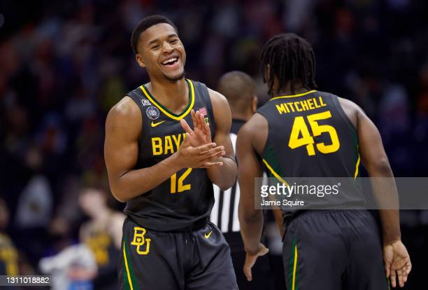Jared Butler and Davion Mitchell of the Baylor Bears celebrate in the second half of the National Championship game of the 2021 NCAA Men's Basketball...