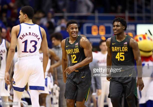 Jared Butler and Davion Mitchell of the Baylor Bears smile as Baylor defeats the Kansas Jayhawks to win the game at Allen Fieldhouse on January 11,...
