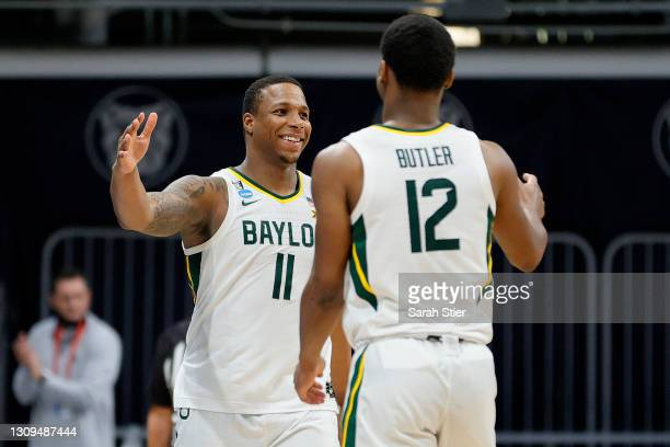 Jared Butler and Mark Vital of the Baylor Bears celebrates in the final moments of their Sweet Sixteen game against the Villanova Wildcats in the...