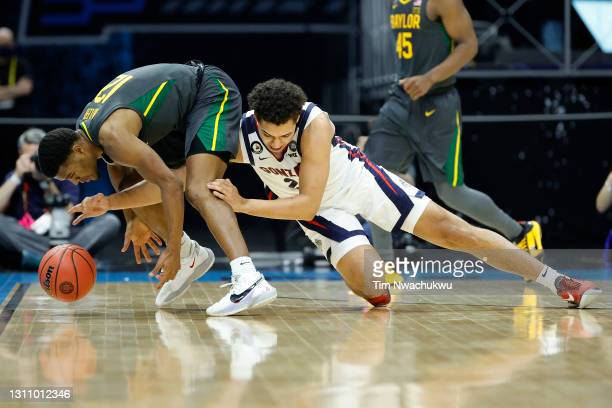 Jared Butler of the Baylor Bears and Anton Watson of the Gonzaga Bulldogs fight for a loose ball in the National Championship game of the 2021 NCAA...