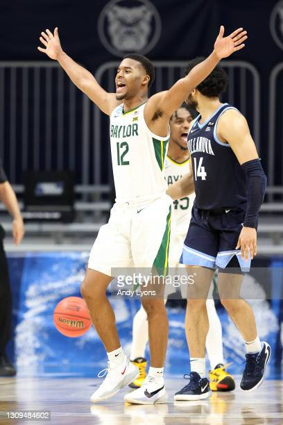 Jared Butler of the Baylor Bears celebrates after a play against the Villanova Wildcats in the second half of their Sweet Sixteen game of the 2021...