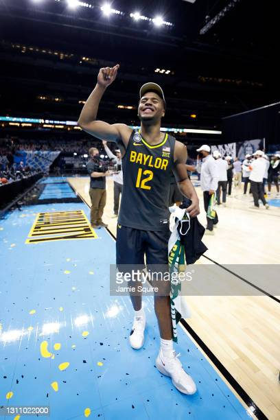 Jared Butler of the Baylor Bears celebrates on the court after defeating the Gonzaga Bulldogs 86-70 in the National Championship game of the 2021...