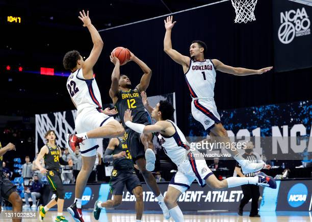 Jared Butler of the Baylor Bears drives to the basket against Anton Watson, Andrew Nembhard and Jalen Suggs of the Gonzaga Bulldogs during the second...