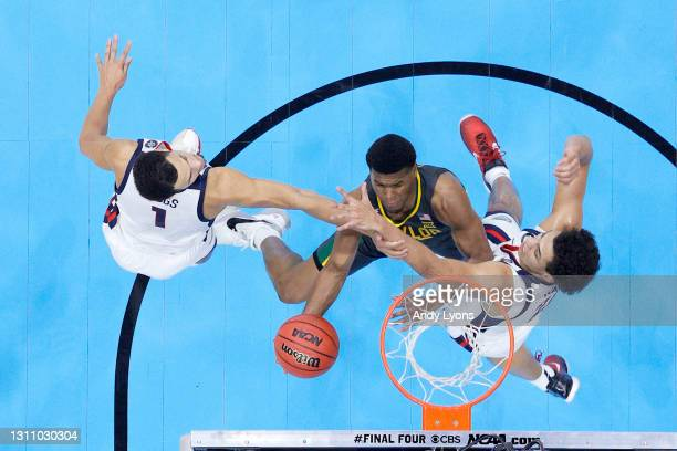 Jared Butler of the Baylor Bears drives to the basket against Jalen Suggs and Anton Watson of the Gonzaga Bulldogs during the second half in the...